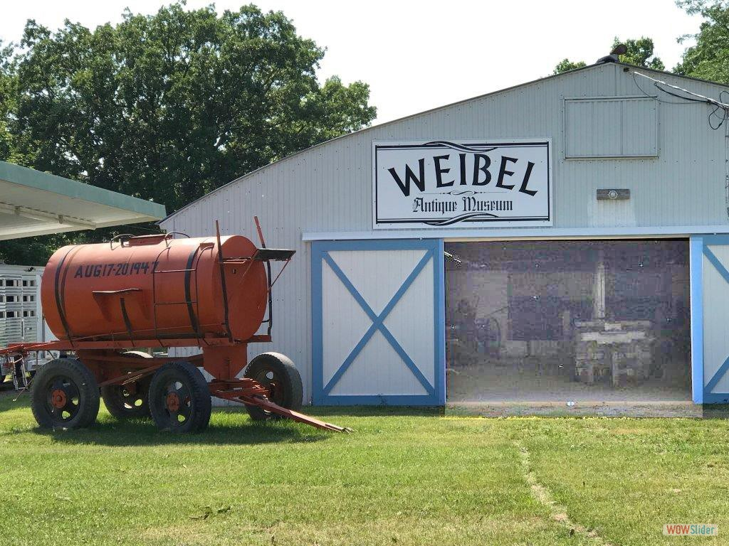 Weibel Antique Museum with Open Doors.  The Water Wagon was from the 1947 Wapello County Fair